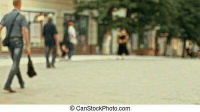Pedestrians in the street blurred background bokeh. City...