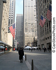 This is a street in Rockefeller center close to traffic.