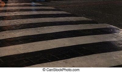 pedestrians walking on public street at night