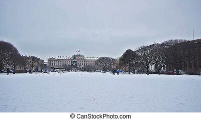 Pedestrians walking through Saint Isaac's Square, Saint Petersburg