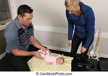 Pediatric Chiropractic - A chiropractor treating a new born...