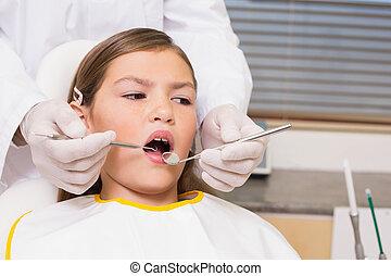 Pediatric dentist examining