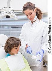 Pediatric dentist showing