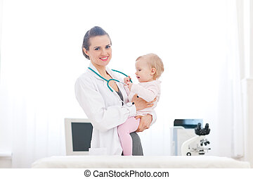 Pediatric doctor and baby on survey