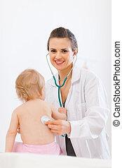 Pediatric doctor examine baby using stethoscope
