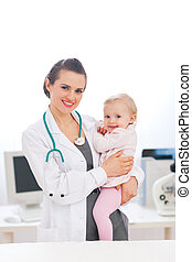 Pediatric doctor with baby on survey