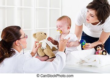 pediatric health care - mother and baby in pediatrician...
