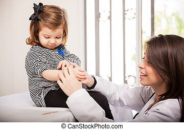 Pediatrician applying a bandage