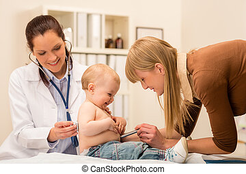 Pediatrician check-up baby girl with stethoscope