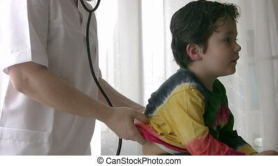 Pediatrician checking Little boy
