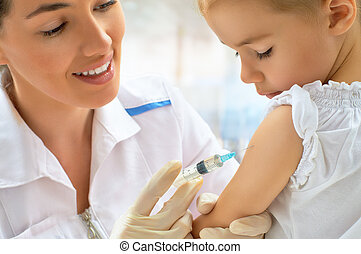 pediatrician - doctor examining a child in a hospital