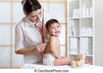 pediatrician doctor examining heartbeat of baby with stethoscope