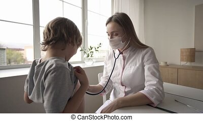Pediatrician doctor woman uniform hold stethoscope annual check up toddler boy by monitoring heart pulse rate. Healthcare concept
