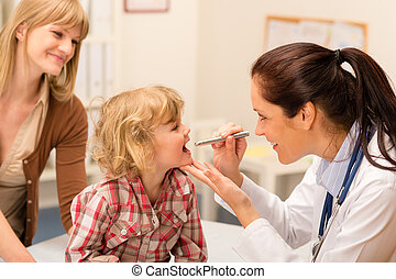 Pediatrician examine child throat look with light - Little...