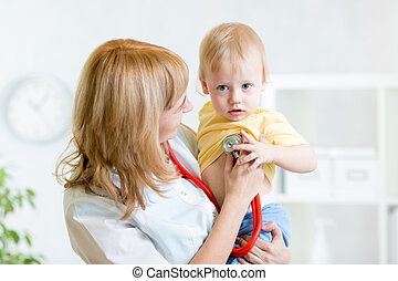pediatrician examining heartbeat of baby with stethoscope