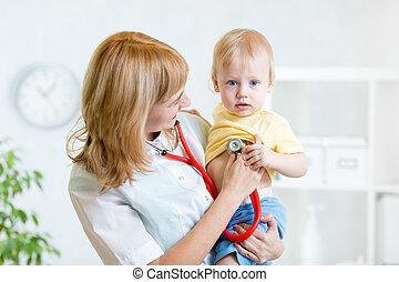 pediatrician examining heartbeat of kid with stethoscope