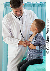 Pediatrician examining little boy