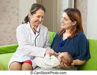 pediatrician examining newborn baby