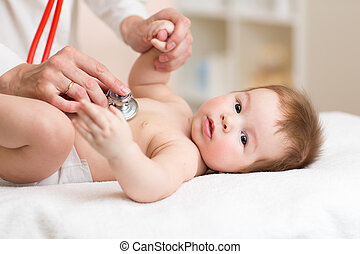 Pediatrician examining three months old baby. Doctor using a stethoscope to listen to kid chest checking heartbeat