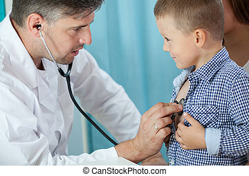 Pediatrician listening preschooler heart - Horizontal view...