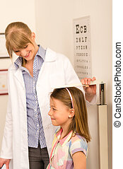 Pediatrician measure height of little girl - Pediatrician...