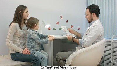 Pediatrician, mother and child atdoctor office. People
