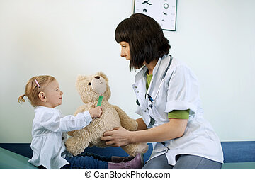 Pediatrician playing with child at doctors office