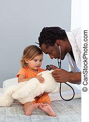 Pediatrician talking to a little girl