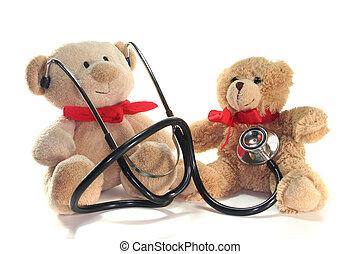 Pediatrician - Teddy-doctor and Teddy-child listens on a...