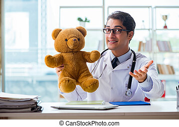 Pediatrician with toy sitting in the office
