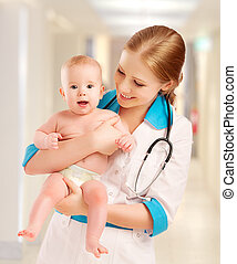 Pediatrician woman doctor holding baby