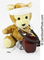 Pediatrics - Apple with toy bear, gauze wrapped about its...
