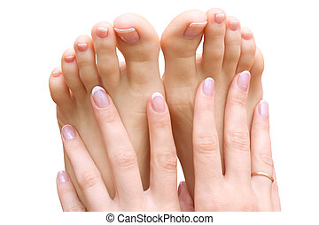 beautifull woman's foot and hands on white background