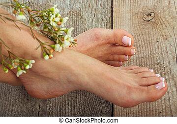 Pedicure - Beauty treatment photo of nice pedicured feet