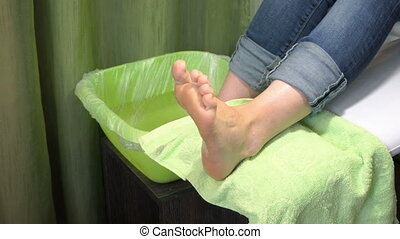 Pedicure procedure in the beauty salon. emover calluses on...