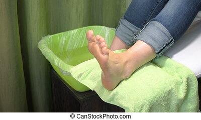 Pedicure procedure in the beauty salon. emover calluses on...