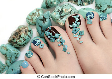 Pedicure with turquoise stones.