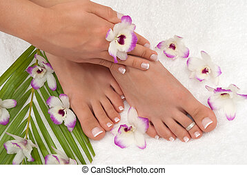 Pedicured feet manicured hands