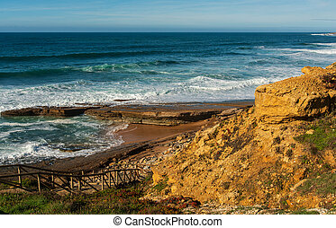 Pedra Branca beach Ericeira village, Portugal. - View of ...