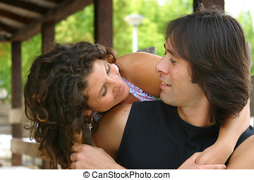Peek-a-boo - Attractive young couple outdoors