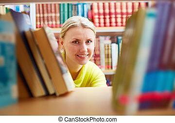 Peeking out of books