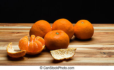Peeled and Unpeeled Tangerines