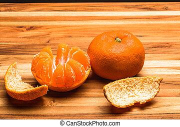 Peeled and Whole Tangerine