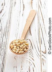 cedar nuts in spoon