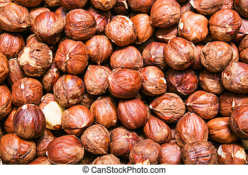 Peeled hazelnuts, cobnuts background or texture