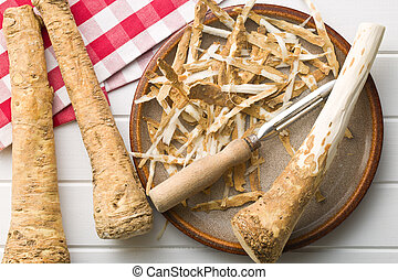 peeled horseradish root on plate