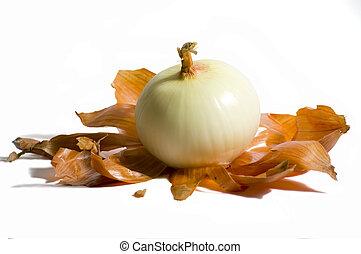 Peeled Onion - Sweet onion peeled sitting on brown skin and...