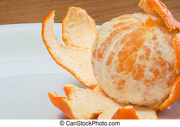Peeled Orange - A peeled orange on a plate ready to be...