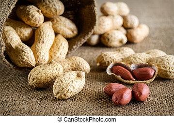 Peeled peanut on well peanuts in background