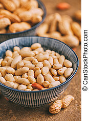 Peeled peanuts in bowls